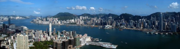 "Picture: ""Hong Kong Victoria Harbour Pano View from ICC 201105"" by WiNG – Own work. Licensed under CC BY-SA 3.0 via Wikimedia Commons."